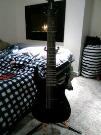 Ibanez 7string electronic guitar amd stand. Cambridge, N3H 5S6