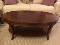 """Oval brown wooden coffee table. L:  48"""". W:  27 3/4"""". H:  19"""" Troy, 48085"""