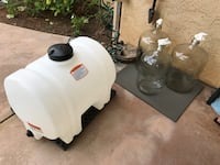 Glass carboys and plastic tank