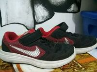 pair of black-and-red Nike running shoes Palmview, 78572
