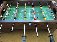 brown and green foosball table