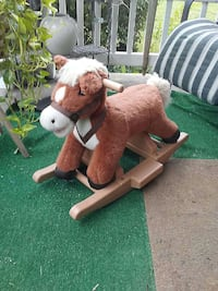 brown and white horse rocking ride on toy