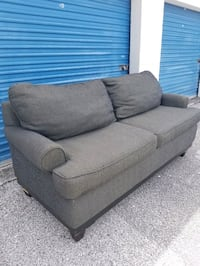 Couch $40 FIRM Kissimmee, 34741
