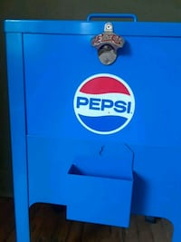 blue and black Pepsi-Cola vending machine Alpena, 49707
