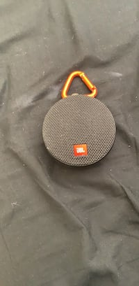 black and orange JBL portable speaker 1143 mi