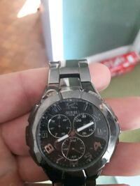 guess brand silver link round chronograph watch