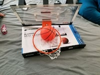 white and orange basketball hoop with box\