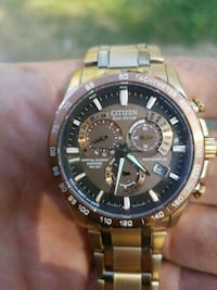 round silver-colored chronograph watch with link b Martensville, S0K 2T0
