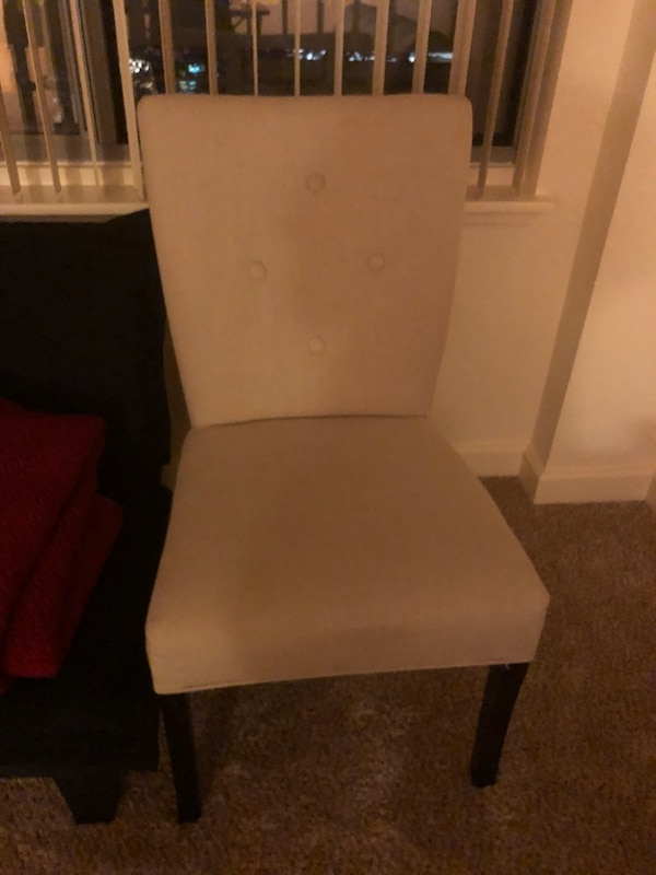 white wooden base with gray padded chair