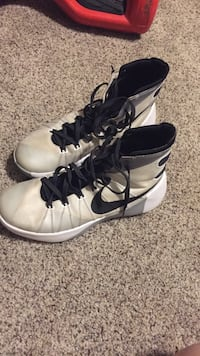 pair of white-and-black Nike basketball shoes Rocky View No. 44, T0J 1X2
