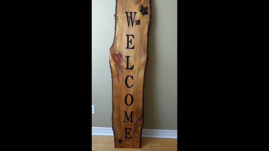 brown wooden Welcome signage