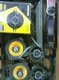 two yellow-and-black subwoofers Regina, S4R 5Y7