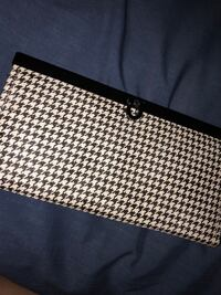 White and black leather wallet with silver sparkle