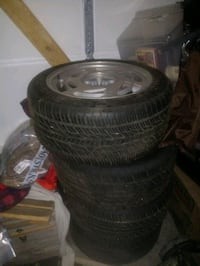4 tires on corvette rims with lug nut tires are brand new