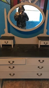 White and blue wooden dresser with mirror