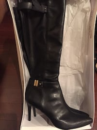 pair of black leather ankle-buckle pump-heeled knee-high boots with box