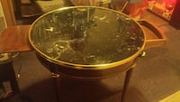 round brown wooden framed glass top table Oakland, 94606