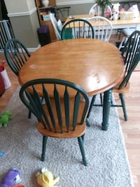round brown wooden table with four chairs dining s Frederick, 21701
