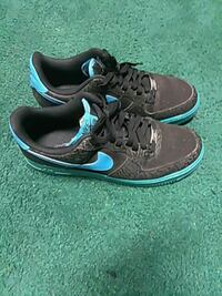 teal-and-black Nike SB sneakers