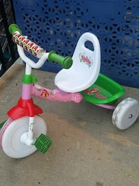 toddler's white, green, and pink Strawberry Shortcake ride-on trike