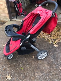 Baby's red and black jogging stroller 30 km