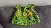 green and yellow knitted cap Houston, 77017