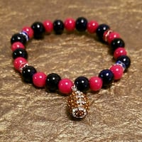 black and red beaded bracelet with gold pendant Hot Springs, 71901