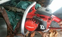 red and black Homelite gas chainsaw