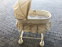 baby's brown and white bassinet Orlando, 32819