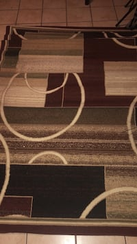 Brown and tan area rug 33 mi