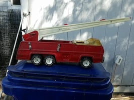 red and white truck toy 50 obo