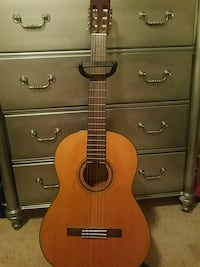 brown and black acoustic guitar Boise, 83709