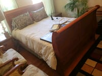brown wooden bed frame with white bed comforter Bowie, 20721