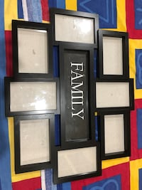 Assorted wooden picture frames.