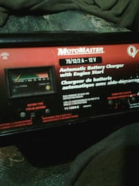 black and red MotoMaster automatic battery charger with engine start