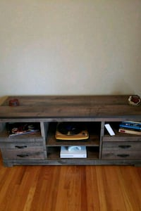 brown wooden TV stand with flat screen television Kansas City, 64133