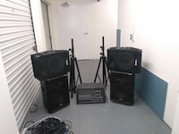 four black PA subwoofer speakers