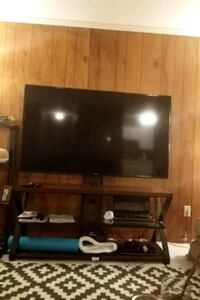 black flat screen TV; brown wooden TV stand Silver Spring, 20906