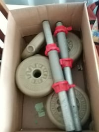 gray dumbbell set with box 516 km