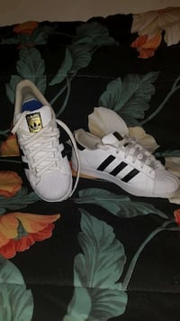 pair of white Adidas Superstar Capitol Heights, 20743