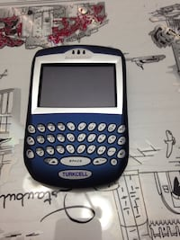 blue and silver blackberry qwerty phone