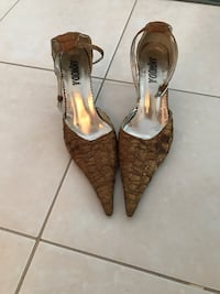 Pair of brown leather pointed-toe pumps