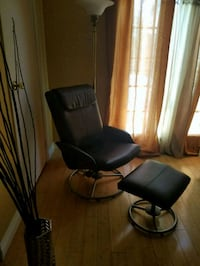 Black recliner chair and foot rest