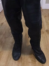 Black leather knee-high boots Coquitlam, V3J 3P8
