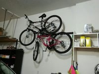 two black and red hardtail bikes