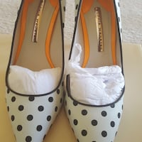 pair of white-and-black leather flats 59 km