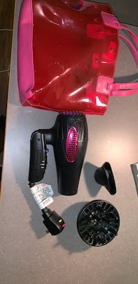 Black and pink hair dryer with attachments and bag
