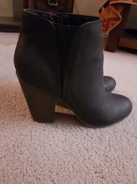 pair of black leather side-zip cone-heeled ankle booties