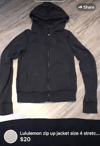 Lululemon zip up jacket charcoal colour size 4 stretchy fitted style with thumb holes used but loved-size 4 London, N5W 6E3