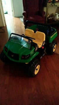 green and yellow ride-on car